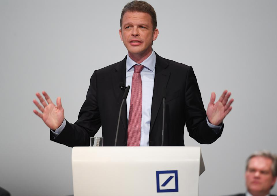 24 May 2018, Germany, Frankfurt: Chairman of the Deutsche Bank, Christian Sewing (R) speaking at the general meeting in the Frankfurt festival hall. The bank is planning the reduction of thousands of positions. The present number of more than 97,000 will be dropped to under 90,000. The insitute announced the news shortly before the start of the general meeting on Thursday. Photo: Arne Dedert/dpa (Photo by Arne Dedert/picture alliance via Getty Images)
