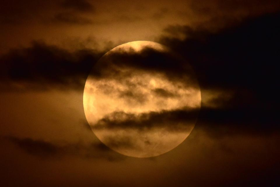 <p>ASSAM,INDIA - MAY 26,2021 -A total lunar eclipse is observed from in Nagaon district in the northeastern state of Assam, India. (Photo credit should read Anuwar Ali Hazarika/Barcroft Media via Getty Images)</p>