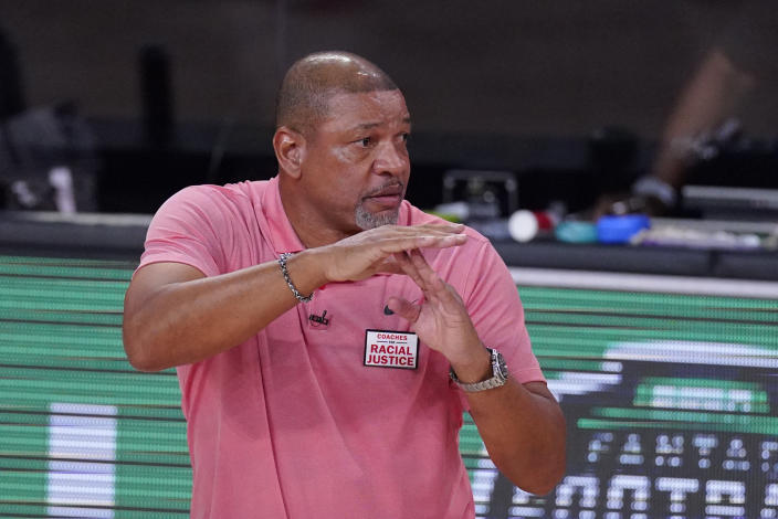 Los Angeles Clippers head coach Doc Rivers calls a timeout during the second half of an NBA conference semifinal playoff basketball game against the Denver Nuggets, Wednesday, Sept. 9, 2020, in Lake Buena Vista, Fla. (AP Photo/Mark J. Terrill)