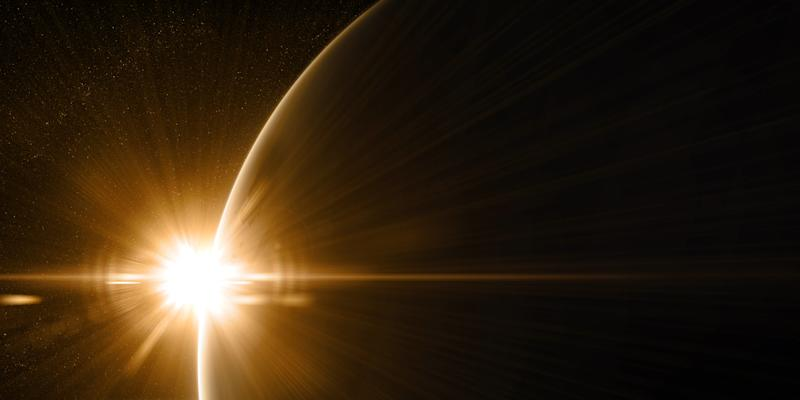 Sunrise in space with prominent sun flare and sun streaks. Golden, orange and yellow color scheme.Elements of this image furnished by NASA. 3d illustration