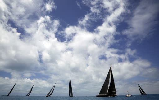 FILE - In this June 19, 2017, file photo, J Class boats race as part of America's Cup sailing event, in waters off of Bermuda. Government agencies probing possible misuse of public funds in the staging of next years Americas Cup sailing regatta have also expressed concerns about Cup organizers ability to host a safe and successful event. A June 22, 2020, letter to Team New Zealand and Americas Cup Events from the heads of a government ministry and the Auckland City Council, obtained by New Zealand media, raises questions about the use of taxpayer funds allocated to assist in the staging of the 36th Cup defense in 2021. (AP Photo/Gregory Bull, File)