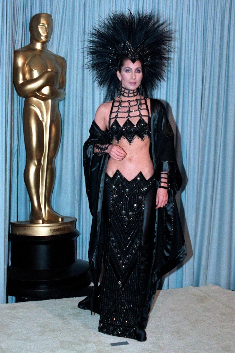 """<p>Cher infamously wore her controversial 1986 Oscar gown <a href=""""https://people.com/style/cher-says-she-wore-her-controversial-1986-oscars-gown-to-send-a-message-to-the-academy/"""" rel=""""nofollow noopener"""" target=""""_blank"""" data-ylk=""""slk:to spite the Academy"""" class=""""link rapid-noclick-resp"""">to spite the Academy</a>, and accidentally landed herself on the list of most amazing Oscar dresses of all time! </p>"""