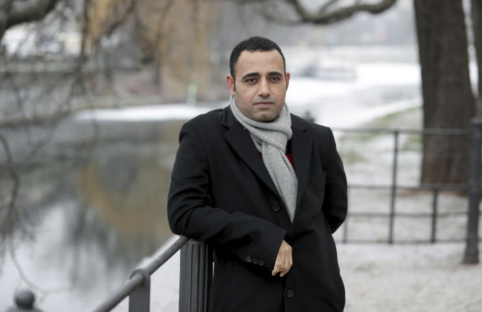 Egyptian political exile and academic Taqadum al-Khatib poses for a photograph in Berlin, Jan. 18, 2021. The Jan. 25, 2011, uprising in Tahrir Square led to the quick ouster of autocrat Hosni Mubarak. A decade later, thousands are estimated to have fled abroad to escape a state, headed by President Abdel Fattah el-Sissi, that is even more oppressive. (AP Photo/Michael Sohn)