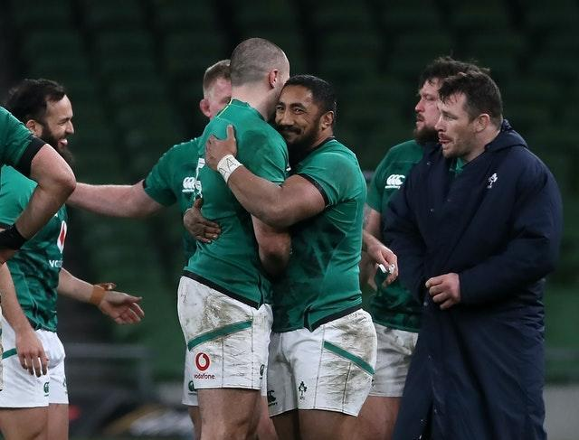 Jacob Stockdale, centre left, and Bundee Aki celebrate Ireland's win