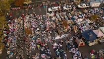 Fire evacuees sift through a surplus of donated items at a parking lot in Chico, California
