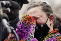 Katie Wright, mother of Daunte Wright, cries as she speaks during a news conference in snowfall, Tuesday, April 13, 2021, in Minneapolis. Daunte Wright, 20, was shot and killed by police Sunday after a traffic stop in Brooklyn Center, Minn. (AP Photo/John Minchillo)