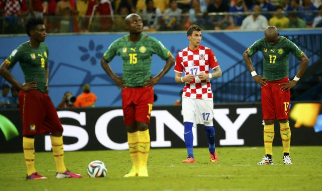 Cameroon's players wait to restart the match after Croatia's Mario Mandzukic (2nd R) scored their team's fourth goal during their 2014 World Cup Group A soccer match at the Amazonia arena in Manaus June 18, 2014. REUTERS/Murad Sezer (BRAZIL - Tags: SOCCER SPORT WORLD CUP)
