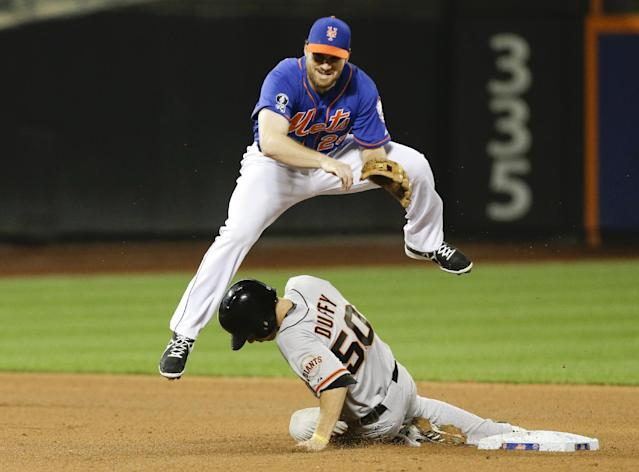 New York Mets' Daniel Murphy (28) jumps to avoid San Francisco Giants' Matt Duffy (50) after forcing him out at second base during the seventh inning of a baseball game Friday, Aug. 1, 2014, in New York. Buster Posey reached first base on the play. (AP Photo/Frank Franklin II)