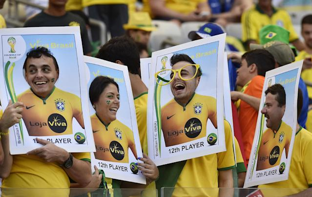 Brazil soccer fans place their faces in a cut-out posters before the World Cup round of 16 soccer match between Brazil and Chile at Mineirao Stadium in Belo Horizonte, Brazil, Saturday, June 28, 2014. (AP Photo/Martin Meissner)
