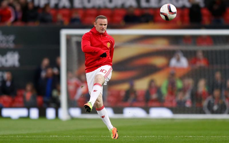 Wayne Rooney has barely stopped smiling for the past 15 minutes - Credit: Martin Rickett/PA