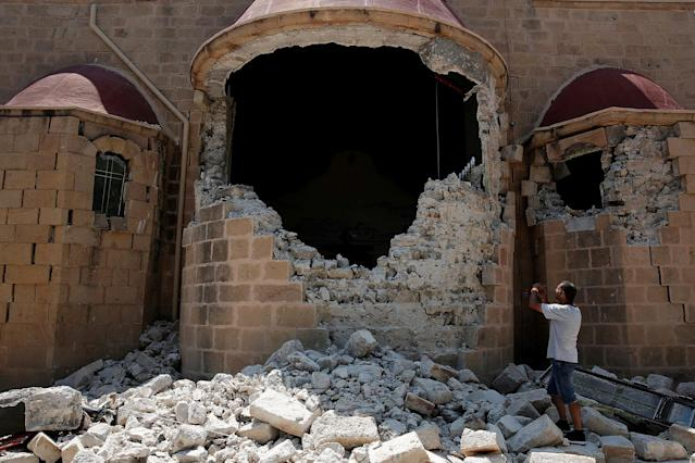 <p>A man takes pictures of a damaged church following an earthquake off the island of Kos, Greece July 21, 2017. (Photo: Costas Baltas/Reuters) </p>