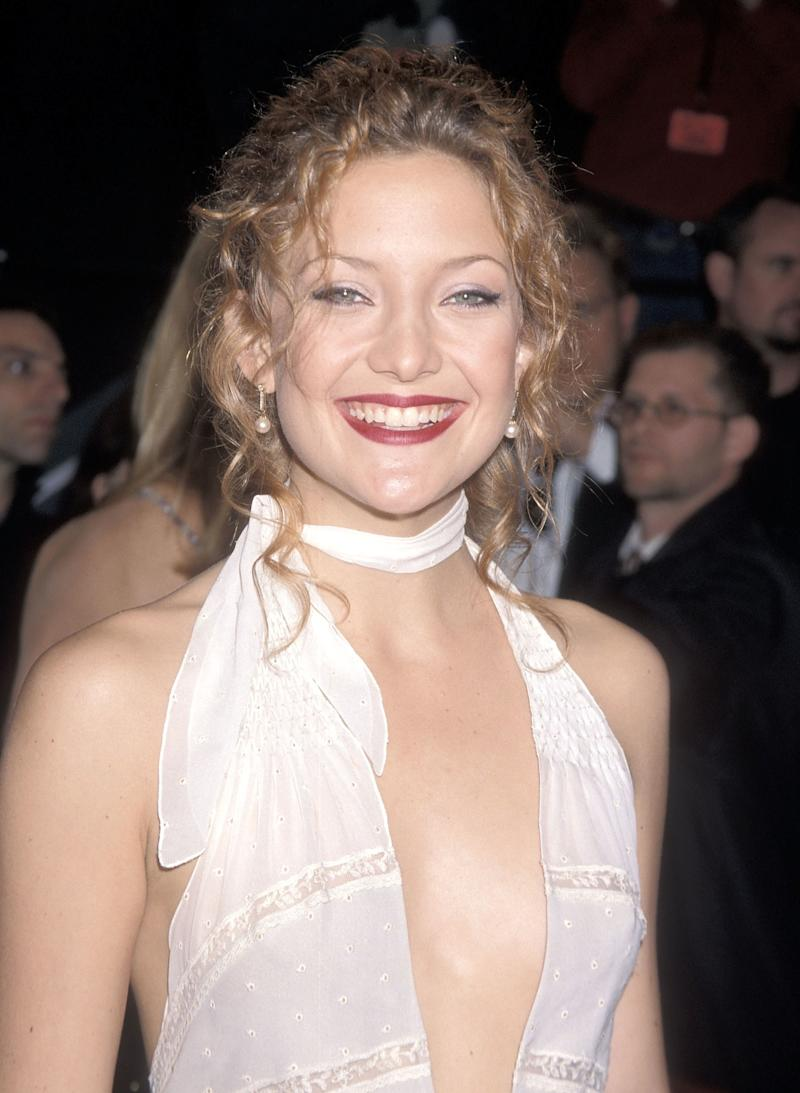 Wearing her natural curls in a tousled up do with a burgundy red lip, Hudson attends the 14th Annual American Comedy Awards in 2000.
