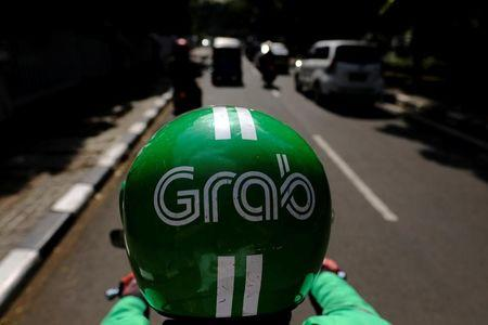 A Grab motor driver is seen in a street in Jakarta