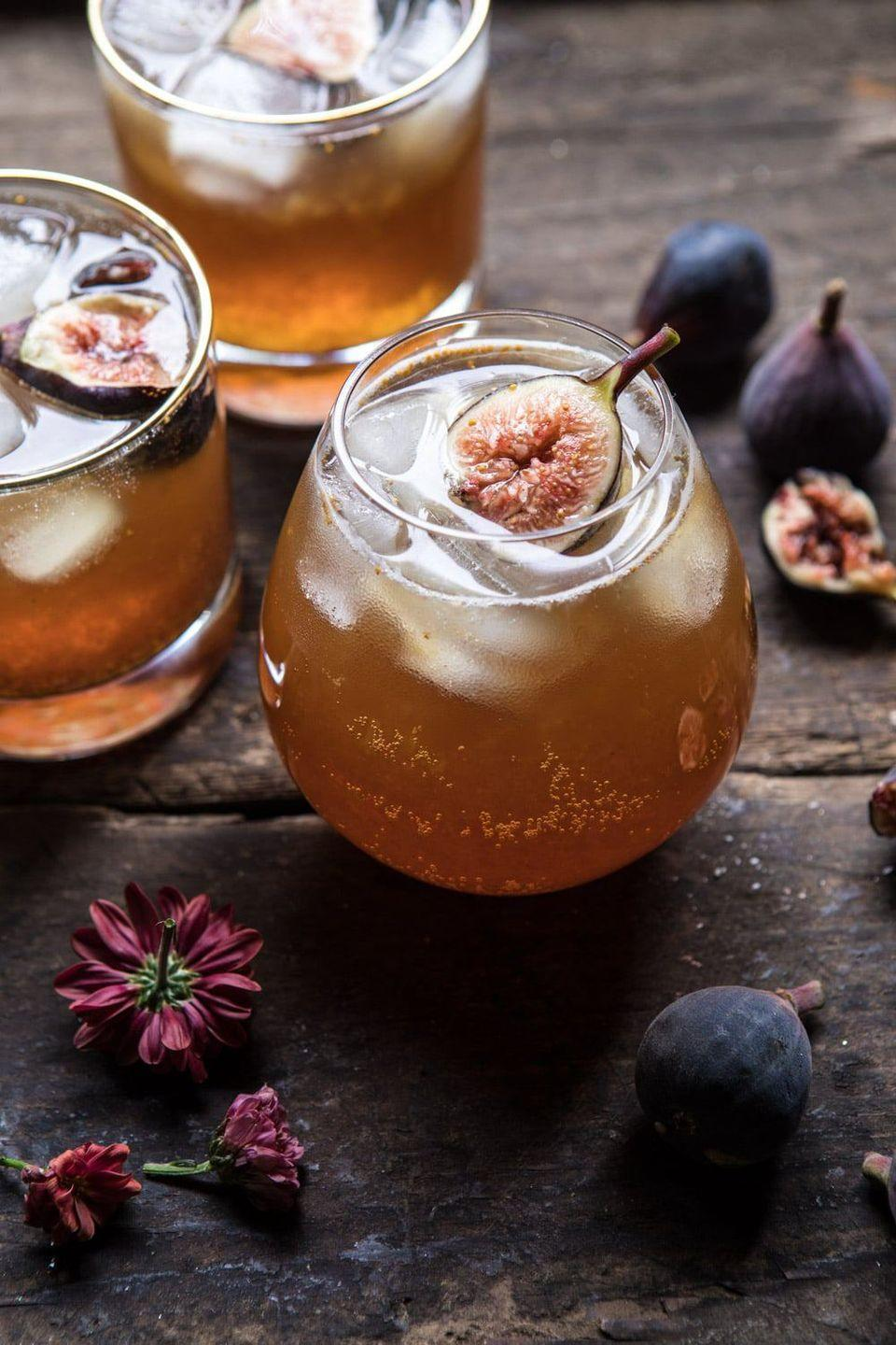 """<p>Figs are totally delicious, and one of the most overlooked flavors of fall. That's why you've got to try this fig-infused bourbon-cider cocktail!</p><p><strong>Get the recipe at <a href=""""https://www.halfbakedharvest.com/fig-bourbon-cider-smash/"""" rel=""""nofollow noopener"""" target=""""_blank"""" data-ylk=""""slk:Half Baked Harvest"""" class=""""link rapid-noclick-resp"""">Half Baked Harvest</a>.</strong></p><p><strong><a class=""""link rapid-noclick-resp"""" href=""""https://go.redirectingat.com?id=74968X1596630&url=https%3A%2F%2Fwww.walmart.com%2Fbrowse%2Fdining-entertaining%2Fdrinkware%2F4044_623679_639999_3148543%3Ffacet%3Dbrand%253AThe%2BPioneer%2BWoman&sref=https%3A%2F%2Fwww.thepioneerwoman.com%2Ffood-cooking%2Fmeals-menus%2Fg33510531%2Ffall-cocktail-recipes%2F"""" rel=""""nofollow noopener"""" target=""""_blank"""" data-ylk=""""slk:SHOP DRINKWARE"""">SHOP DRINKWARE</a><br></strong></p>"""