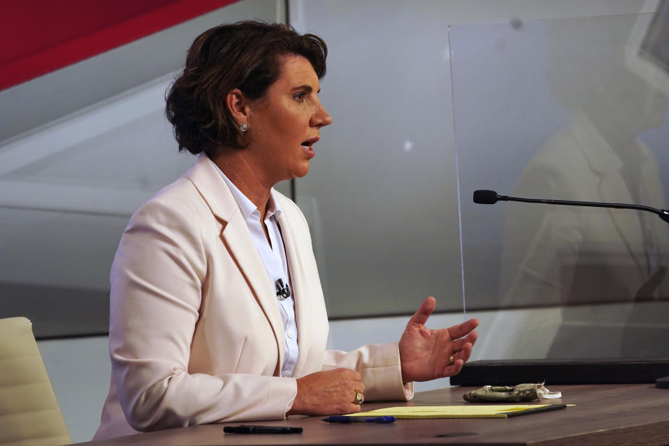 US Senate candidate Amy McGrath speaks during a debate with Senate Majority Leader Mitch McConnell, R-Ky., in Lexington, Ky., Monday, Oct. 12, 2020. (Michael Clubb, The Kentucky Kernel via AP Pool)