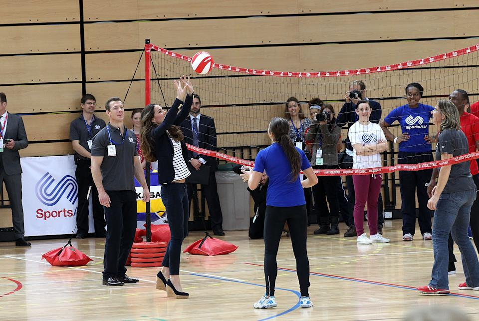 LONDON, ENGLAND - OCTOBER 18:  Catherine, Duchess of Cambridge is seen playing Volleyball at a Sportaid athlete workshop at the Copper Box in the Queen Elizabeth Olympic Park on October 18, 2013 in London, England.  (Photo by Danny Martindale/WireImage)
