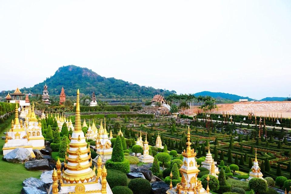 "<p>Stretching over 500 acres in the coastal city of Pattaya, the <a href=""http://www.nongnoochtropicalgarden.com"" rel=""nofollow noopener"" target=""_blank"" data-ylk=""slk:Nongnooch Tropical Garden"" class=""link rapid-noclick-resp"">Nongnooch Tropical Garden</a> contains more than 670 native plant species and quirky exhibitions including a miniature replica of Stonehenge and an ant tower. Pisit and Nongnooch Tansacha first purchased the land in 1954 with the intention to turn the space into a fruit plantation, but later opened the space to the public in 1980 as a tropical flower and plant conservation. Apart from the perfectly manicured gardens, visitors can also enjoy Thai cultural shows, a car museum, a fishing pond, and elephant shows.<br></p>"