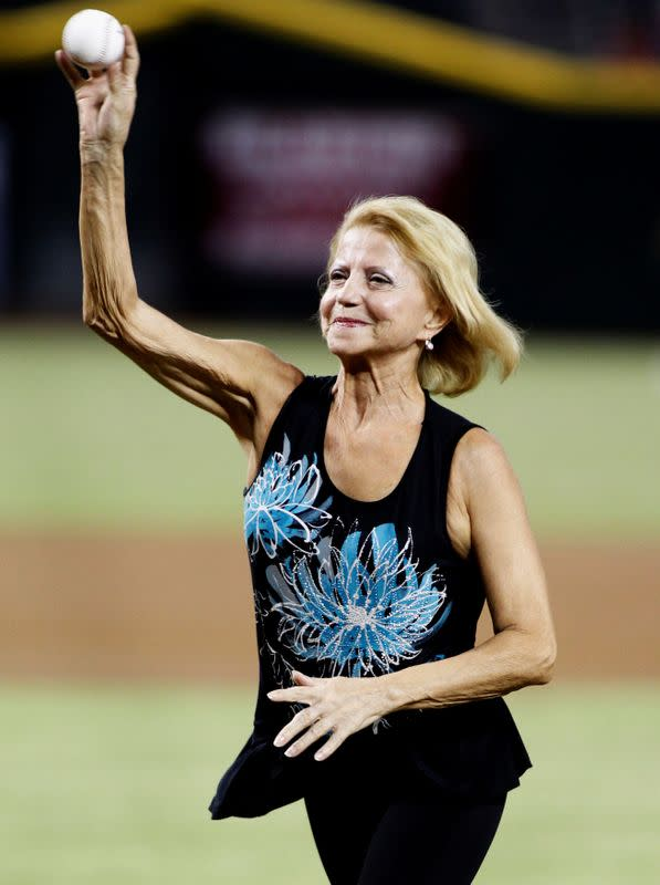 FILE PHOTO: Olympic gold medalist Olga Korbut throws out the first pitch before the start of an MLB interleague game