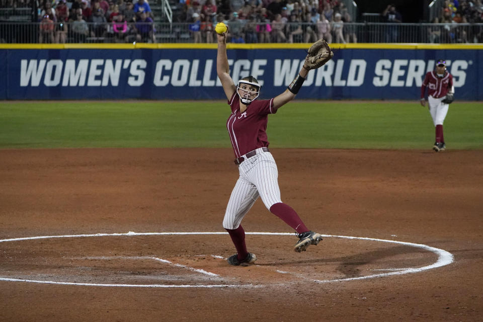 Alabama's Montana Fouts pitches against UCLA in the first inning of an NCAA Women's College World Series softball game Friday, June 4, 2021, in Oklahoma City. (AP Photo/Sue Ogrocki)