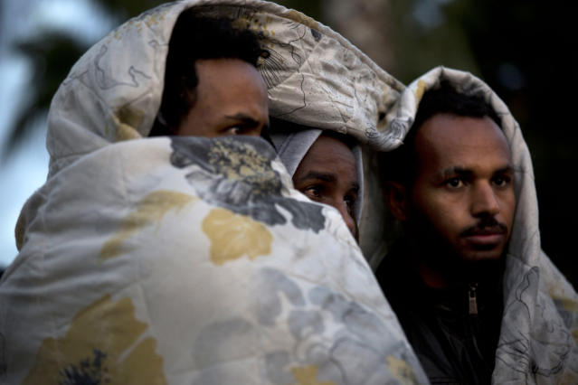 <p>African migrants cover themselves with blankets in the cold during a protest demanding asylum and work rights from the Israeli government in Tel Aviv, Israel, Feb. 3, 2014. (Photo: Oded Balilty/AP) </p>