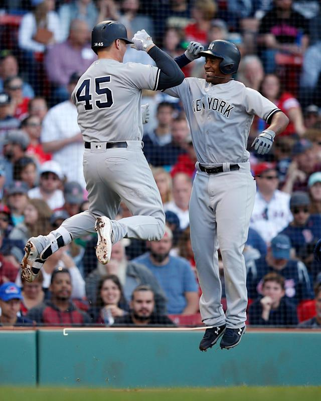New York Yankees' Luke Voit, left, celebrates his two-run home run that also drove in Miguel Andujar, right, during the fourth inning of a baseball game against the Boston Red Sox in Boston, Sunday, Sept. 30, 2018. (AP Photo/Michael Dwyer)