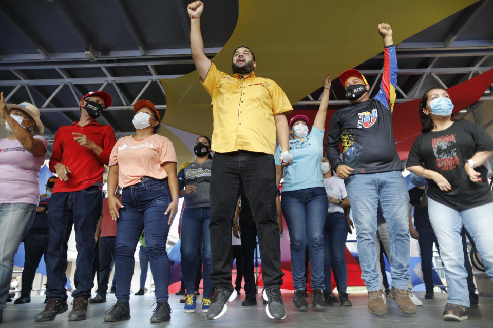 Nicolas Maduro Guerra, son of Venezuela's President Nicolas Maduro, campaigns for a spot in the National Assembly for the upcoming Dec. 6 midterm elections, in Maiquetía, Venezuela, Sunday, Nov. 29, 2020. (AP Photo/Ariana Cubillos)