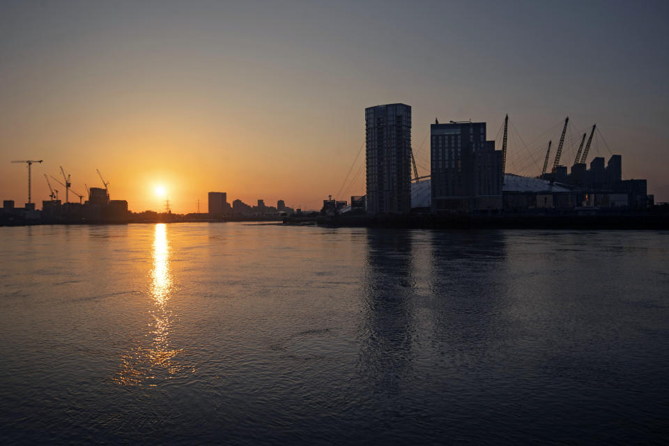 The sun rises over the River Thames in east London, as the UK continues in lockdown to help curb the spread of the coronavirus.