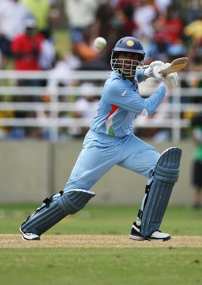 TRELAWNY, JAMAICA - MARCH 09:  Dinesh Karthik of India in action during the ICC Cricket World Cup 2007 Warm Up Match between West Indies and India at the Trelawny Multi Purpose Stadium on March 9, 2007 in Trelawny, Jamaica.  (Photo by Clive Rose/Getty Images)