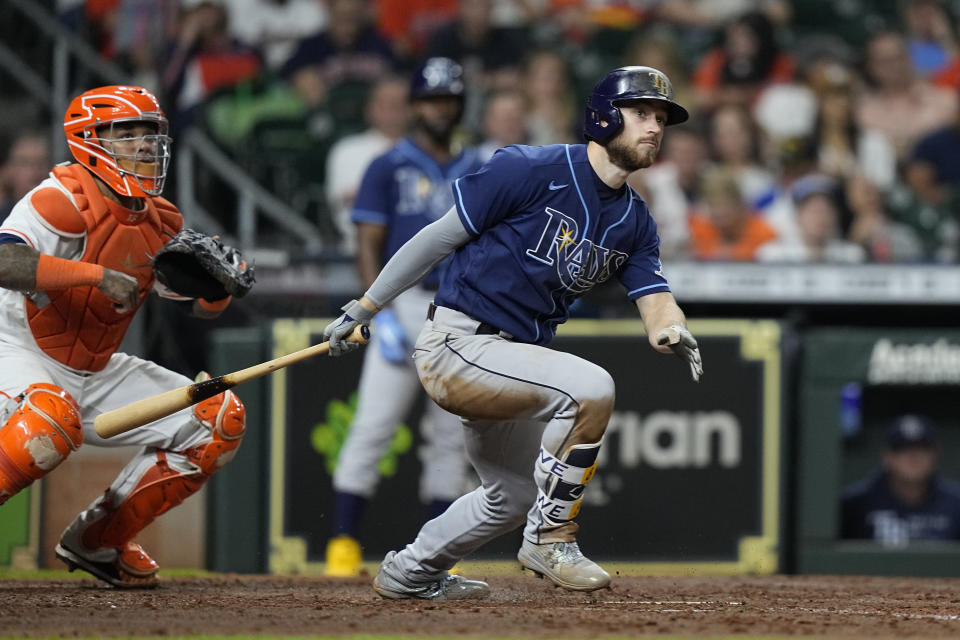 Tampa Bay Rays' Brandon Lowe watches his two-run home run along with Houston Astros catcher Martin Maldonado during the sixth inning of a baseball game Thursday, Sept. 30, 2021, in Houston. (AP Photo/David J. Phillip)