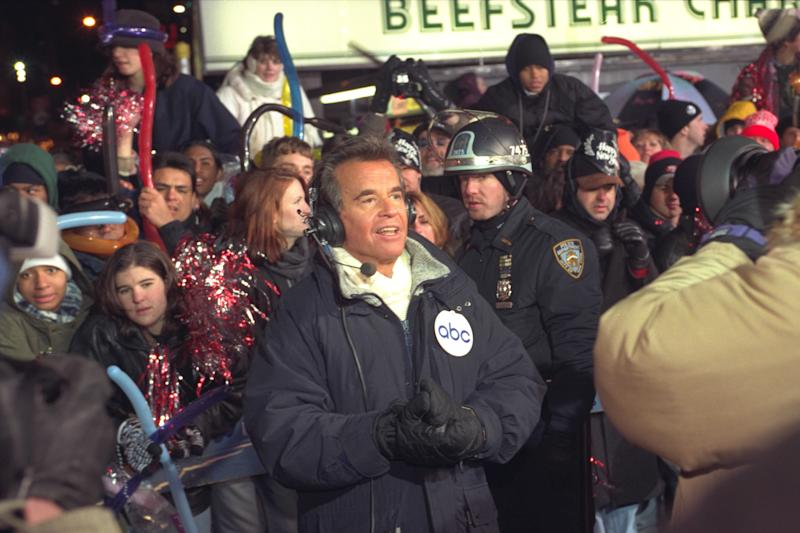 "FILE - In this Dec. 31, 1996 file photo, Dick Clark broadcasts during New Year's festivities from Times Square in  New York.  ABC is turning its first New Year's Eve without Dick Clark in four decades partly into a celebration of the show biz impresario's life. Clark, who originated the annual ""New Year's Rockin' Eve"" special in 1971, died at age 82 in April 18, 2012. Fergie and Jenny McCarthy will be hosts of a two-hour tribute to Clark that will air at 8 p.m. ET on New Year's Eve. ABC said Wednesday, Nov. 28, 2012,  that Ryan Seacrest will host the countdown show from Times Square, with Taylor Swift, Carly Rae Jepsen, Neon Trees, Flo Rida and Pitbull among the musical guests. (AP Photo/Wally Santana)"