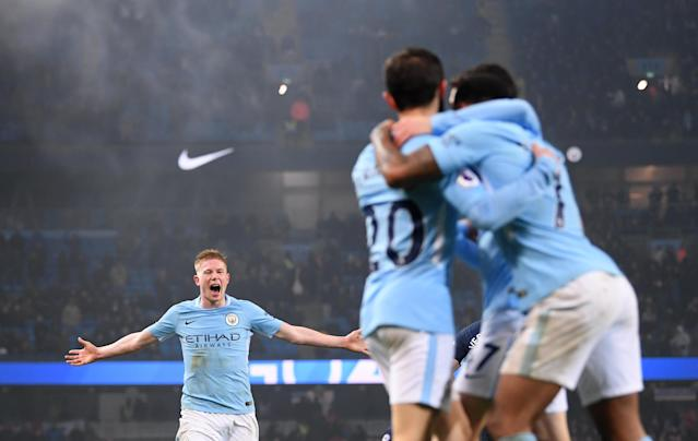 "Manchester City players celebrate one of their four goals in a 4-1 win over <a class=""link rapid-noclick-resp"" href=""/soccer/teams/tottenham-hotspur/"" data-ylk=""slk:Tottenham Hotspur"">Tottenham Hotspur</a> at the Etihad on Saturday. (Getty)"