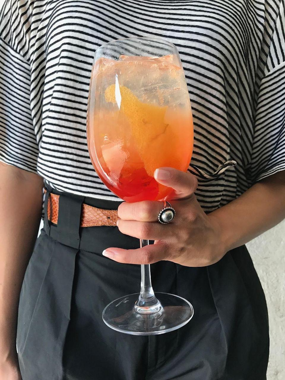 """<p>This refreshing libation comes from <a href=""""http://barbutonyc.com/index.php"""" rel=""""nofollow noopener"""" target=""""_blank"""" data-ylk=""""slk:Barbuto"""" class=""""link rapid-noclick-resp"""">Barbuto</a>, the iconic West Village restaurant. The 1919 Cocktail was the first drink bartender Tyan Cray put on the menu in 2004, and it has remained a mainstay ever since. </p><p><strong>Ingredients:</strong></p><p> 1 1⁄2 ounces Cappelletti Aperitivo wine</p><p>2 ounces fresh grapefruit juice</p><p>4 to 5 ounces dry Prosecco</p><p>Grapefruit peel, for garnish</p><p><strong>Directions:</strong></p><p>In a large wineglass filled with ice, mix the Cappelletti, grapefruit juice, and Prosecco. Stir and express one large grapefruit peel over the glass. Garnish with the peel. </p>"""
