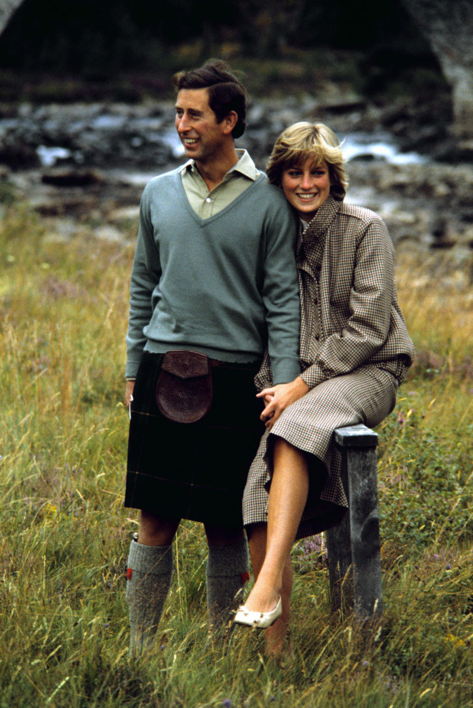 <p>Following their wedding, Prince Charles and Princess Diana headed to Balmoral. Here, Princess Diana opted for a tweed two-piece and finished the look with of-the-era feathered locks.<br><em>[Photo: PA]</em> </p>