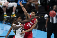 Baylor forward Jonathan Tchamwa Tchatchoua (23) passes around Houston guard Quentin Grimes (24) during the second half of a men's Final Four NCAA college basketball tournament semifinal game, Saturday, April 3, 2021, at Lucas Oil Stadium in Indianapolis. (AP Photo/Michael Conroy)