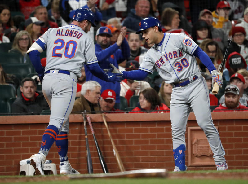 New York Mets' Pete Alonso (20) is congratulated by Michael Conforto (30) after hitting a solo home run during the sixth inning of a baseball game against the St. Louis Cardinals on Friday, April 19, 2019, in St. Louis. (AP Photo/Jeff Roberson)