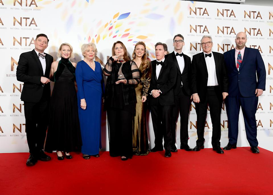"""LONDON, ENGLAND - JANUARY 28: (L to R) Mathew Horne, Joanna Page, Alison Steadman, Ruth Jones, Laura Aikman, Rob Brydon, Robert Wilfort, Larry Lamb and guest, accepting the Impact Award for """"Gavin and Stacey, Christmas Special"""", pose in the winners room   during the National Television Awards 2020 at The O2 Arena on January 28, 2020 in London, England. (Photo by Gareth Cattermole/Getty Images)"""