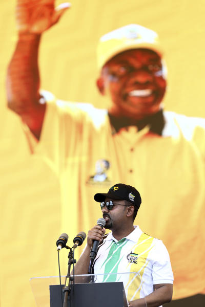 Ethiopian Prime Minister Abiy Ahmed Ali, addresses supporters in front of a backdrop showing African National Congress (ANC) president and South African President Cyril Ramaphosa, at the party's 108th birthday celebrations in Kimberley, South Africa, Saturday, Jan. 11, 2020. (AP Photo)