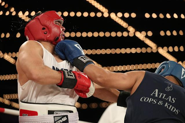 <p>Robert Cruz (red) gets a wake-up call from Johnny Orellano (blue) in the Executive Decision Match during the NYPD Boxing Championships at the Hulu Theater at Madison Square Garden on March 15, 2018. (Gordon Donovan/Yahoo News) </p>