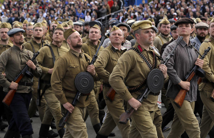 People dressed in old uniforms march during the Victory Day military parade that marked the 75th anniversary of the allied victory over Nazi Germany, in Minsk, Belarus, Saturday, May 9, 2020. Belarus remains one of the few countries that hadn't imposed a lockdown or restricted public events despite recommendations of the World Health Organization. (AP Photo/Sergei Grits)