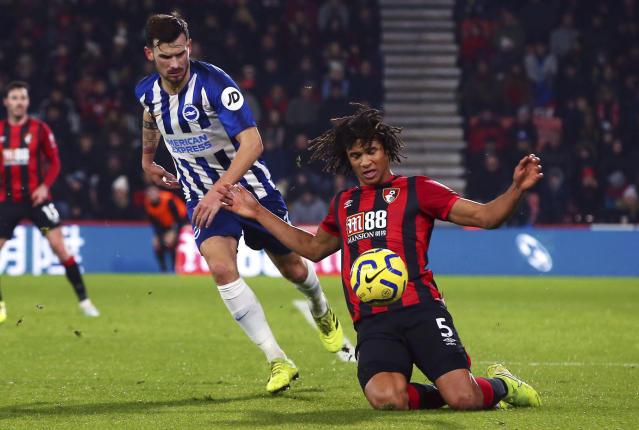 Bournemouth's Nathan Ake, right, and Brighton and Hove Albion's Pascal Gross during their English Premier League soccer match at the Vitality Stadium in Bournemouth, England, Tuesday Jan. 21, 2020. (Mark Kerton/PA via AP)