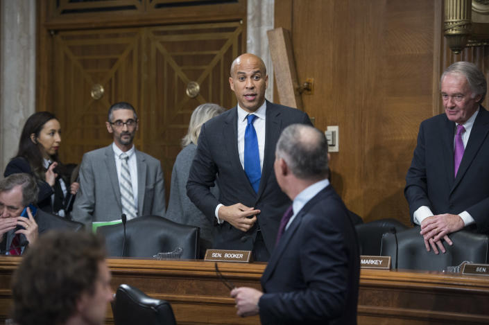 Sen. Cory Booker, D-N.J., talks with Scott Pruitt, President Trump's nominee to be administrator of the Environmental Protection Agency, during his Senate Environment and Public Works Committee confirmation hearing in Dirksen Building, January 18, 2017. (Photo: Tom Williams/CQ Roll Call)