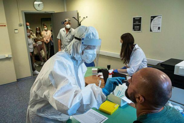 PHOTO: A medical worker performs a COVID-19 test at a test center at Vnukovo International Airport outside Moscow, Russia, on Aug. 7, 2020. (Pavel Golovkin/AP)