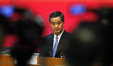Hong Kong Chief Executive Leung Chun-ying looks on in between video cameras during a news conference in Hong Kong in this July 15, 2014 file photo. REUTERS/Bobby Yip/Files