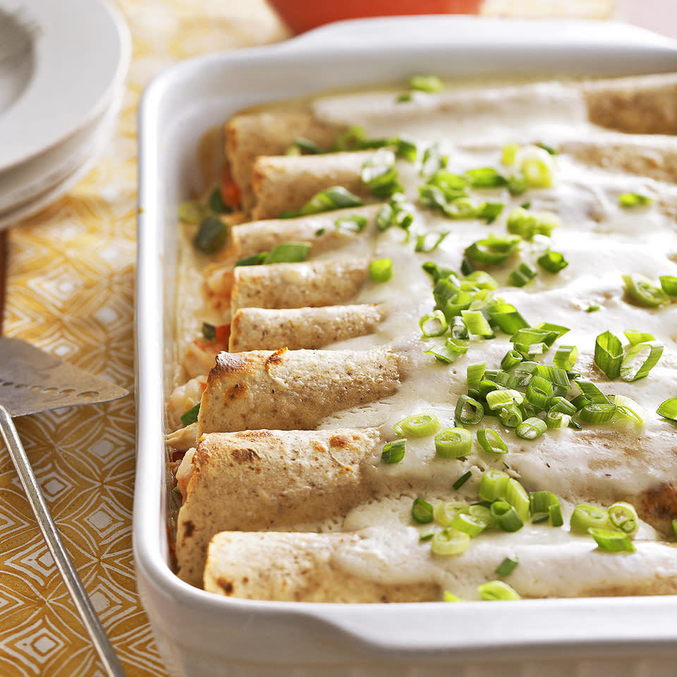 "<p>Seafood enchiladas are topped with a creamy but light sauce for rich flavor without all the extra calories. <a href=""http://www.eatingwell.com/recipe/263488/seafood-enchiladas/"" rel=""nofollow noopener"" target=""_blank"" data-ylk=""slk:View recipe"" class=""link rapid-noclick-resp""> View recipe </a></p>"