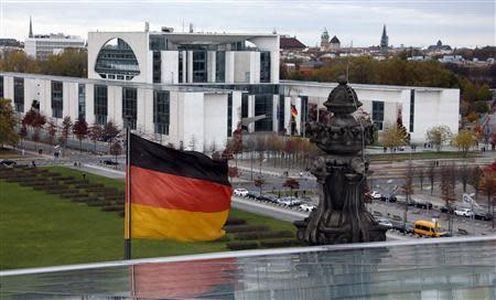 A German national flag flutters in front of the Chancellery in Berlin October 27, 2013. REUTERS/Fabrizio Bensch