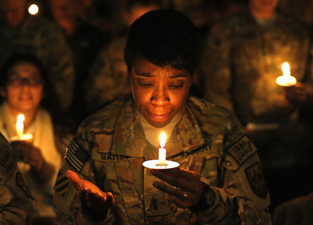 <p>U.S. troops from the Nato-led International Security Assistance Force (ISAF) light candles during Christmas Eve celebrations at Bagram Airfield, north of Kabul, Dec. 24, 2014. (Photo: Mohammad Ismail/Reuters) </p>