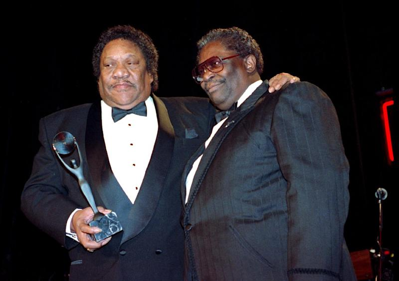 "FILE - In this Jan. 15, 1992, file photo, Bobby ""Blue"" Bland, left, receives his award for the Rock and Roll Hall of Fame from B.B. King during induction ceremonies in New York. Bland's son Rodd said his father died Sunday, June 23, 2013, at his Memphis home surrounded by relatives. He was 83. (AP Photo/Mark Lennihan, File)"
