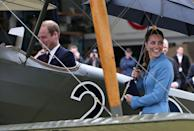 """<p>Will is a pilot, right? He went inside a Sopwith Pup at the """"Knights of the Sky"""" exhibition in Wellington, New Zealand, while Kate held her own umbrella (!) and observed in a sky blue Alexander McQueen coat.</p>"""