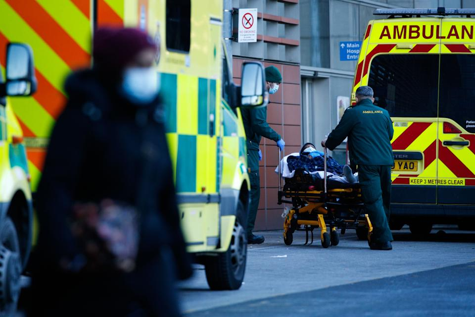 Paramedics wheel a patient into the emergency department of the Royal London Hospital in London. (Photo: NurPhoto via Getty Images)