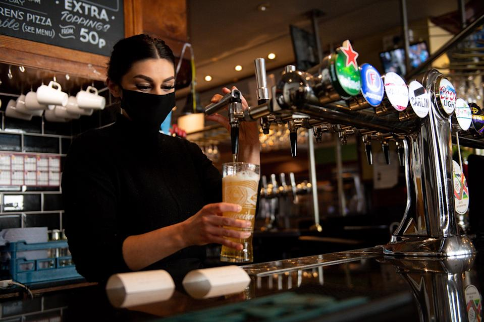 <p>Thousands of staff are set to return to work in pubs, bars and restaurants across England next week</p> (PA)